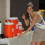 South Dakota Snow Queen Aly Perry, a Frederick High School graduate, helps with serving drinks at the community dinner June 15 during Finn Fest in Frederick, S.D. Photo courtesy fredericksd.com
