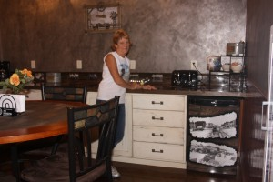 Sherie Tellinghuisen in a kitchen area in the Home Town Hotel in Willow Lake. Photo by Clark County Courier