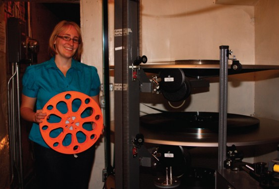 The reel that Jen Carstensen is holding is how new movies come to the Bryant Cinema. Clark County Courier photo