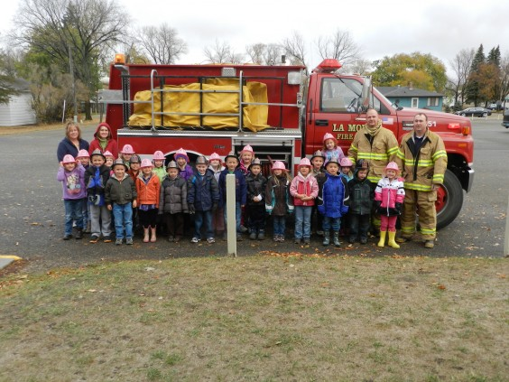 Firemen visted the LaMoure school to talk with the kindergarten class about fire prevention. Photo by LaMoure Chronicle.