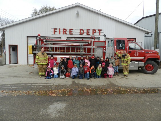 Firemen gave a tour of the fire hall to second-graders from LaMoure school during Fire Prevention Week. Photo by LaMoure Chronicle.