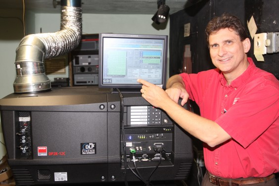 Tom Farber stands next to the new digital equipment in the Strand Theatre in Britton. Britton Journal photo