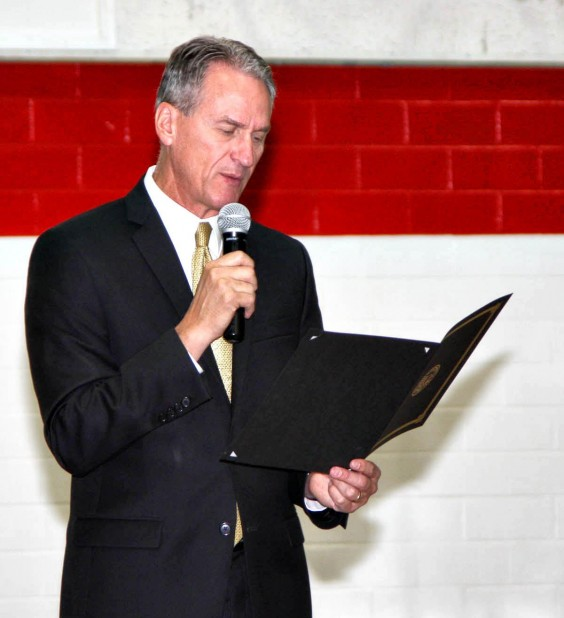 Governor Dennis Daugaard read a proclamation designating Britton as South Dakota'€™s Capital for a Day during a gathering at Amacher Auditorium Oct. 3. Photo by The Britton Journal