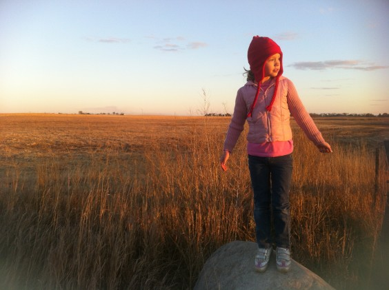 "Sofia Losure, age 6, posing on the ""big rock"" while on a walk with her mom. By Heidi Marttila-Losure"