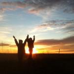 Silhouetted kids in Dakota sunset. Photo by Heidi Marttila-Losure