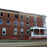 A fence keeps people back from the crumbling Waldorf Hotel in Andover, S.D. Photo by Troy McQuillen