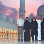 Josh Wagner and Art Steiner are pictured with Lori, Andrea and Karli Opitz garbed in burkas at the Grand Mosque. A dress code was enforced here, and women were required to cover their hair. Photo by (Webster) Reporter & Farmer
