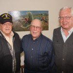 Carroll Peterson, left, of Webster, and John Audus, middle, of Clark, were in the same company in World War II, unbeknownst to each other. Marlin Fjelland, right, of Clark, found out about them both being on the same plane for a short while on Christmas Day 1944. Fjelland helped the two get acquainted and reminisce about this fateful trip home. Photo by Clark County Courier