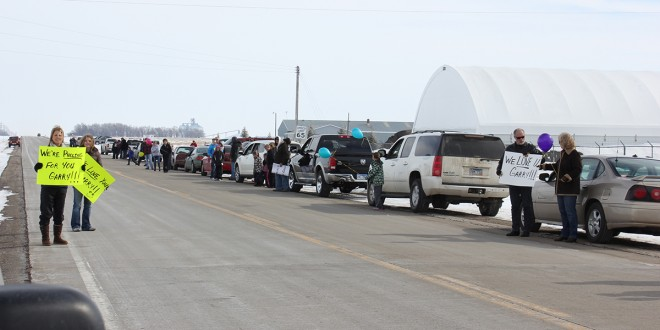 Faulkton community creates convoy of well wishes for beloved coach