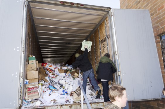 Marshall County 4-Hers Kordell Feldhaus and Weston Henschell add paper to the heap in their recycling trailer. Photo by Troy McQuillen.