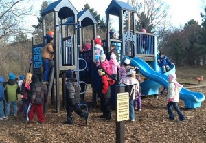 Frederick elementary students try out new play equipment after it was installed at the school last fall. The intended ages for the structure are posted on a sign in front of it. Photo courtesy Frederick Area School