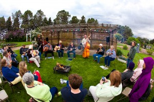 The Rural Art and Culture Summit in Morris, Minn., in June drew people from all over the region to discuss how the arts could be leveraged to create vibrant communities. One evening gathering took place outside, despite cool June temperatures. Photo by Holly Diestler