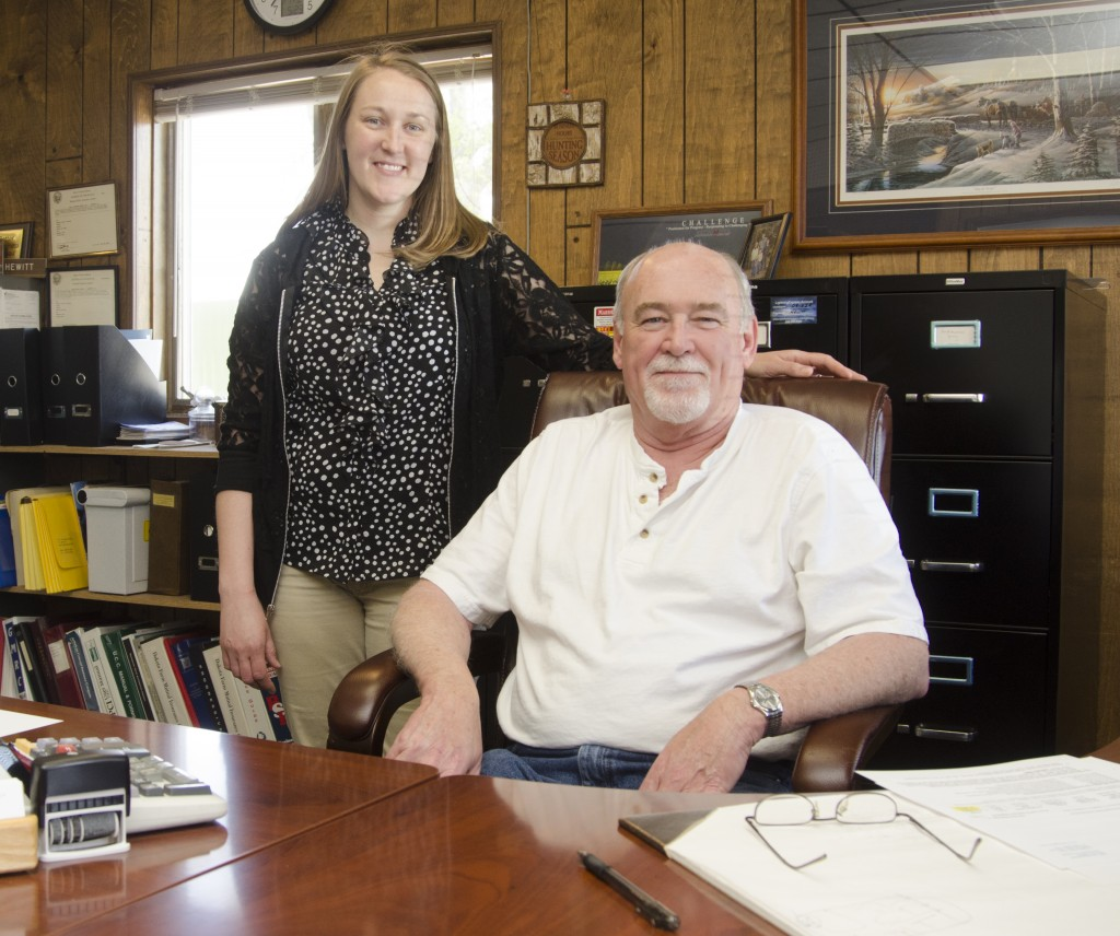 Kayla Suther works with her father, Craig Hewitt, at Hewitt Insurance Agency. Since they both grew up in Langford, they shared similar experiences—like participating in the high school play. Photo by Troy McQuillen
