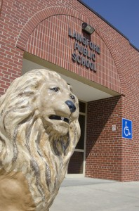 One of the lions guarding the door of the Langford school. Photo by Troy McQuillen