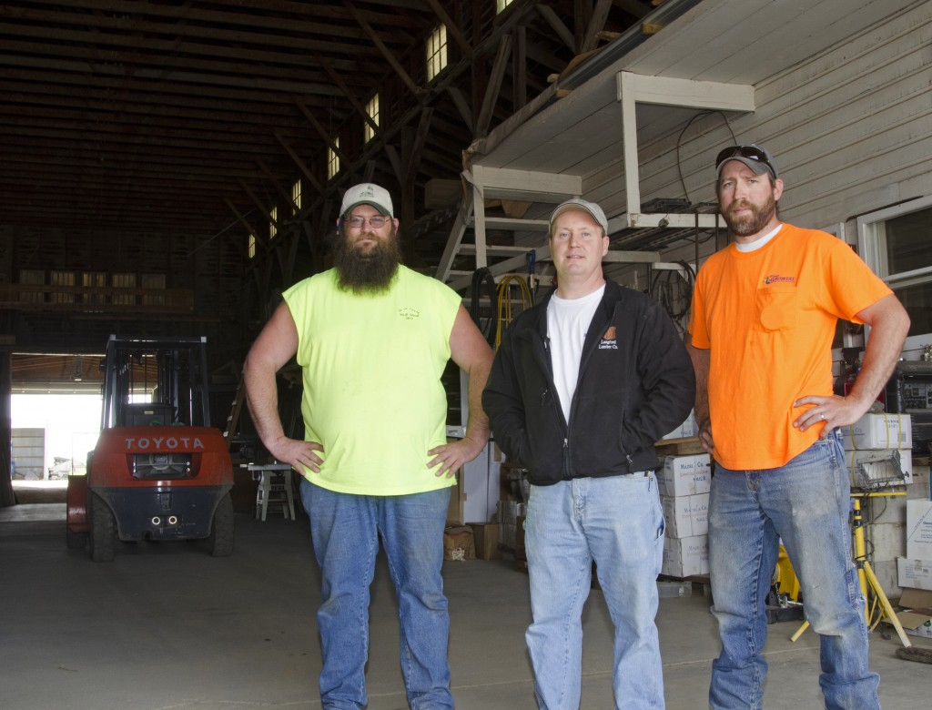 Chad Hardy, center, owns the Langford Lumber Company. Russell Crosby, left, works at the lumber yard, and Joe Keogh is a regular customer at the lumber yard through his work as assistant city manager. Photo by Troy McQuillen