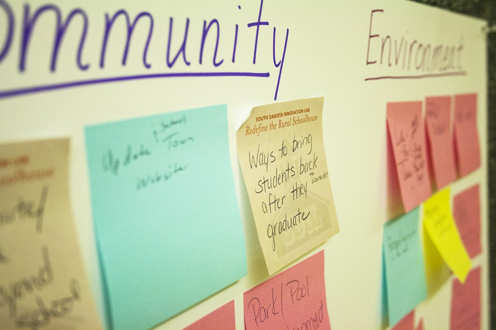 Teachers started their training with a brainstorming session of the needs in their communities. They organized their sticky notes on a wall. Photo by Heidi Marttila-Losure