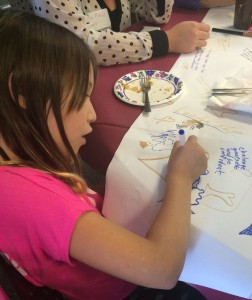 """Caroline Mahin added her own comment to the table drawings: """"Challenge yourself and be confident."""" Photos by Heidi Marttila-Losure"""