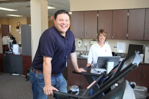 The Marshall County Healthcare Center uses the latest exercise technology for cardiac rehab but also to promote wellness. Picture here are Nick Fosness with Allison Tank, RN and cardiac rehab director. Photo by Doug Card