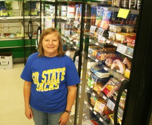 """Deb Holmstrom manages Lake Grocery in Willow Lake. """"I really like it here,"""" she said. """"Everybody looks out for you."""""""