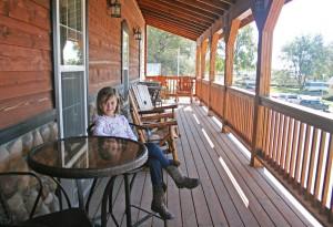 Ella Vandersnick smiles on the balcony of Hometown Hotel in Willow Lake.