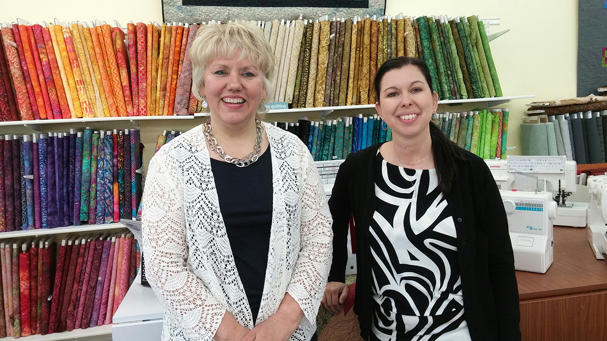 Lori Holt and Stacy Hadrick of Quilter's Corner in Faulkton have added a variety of products and services in recent years. Photo by Laura Melius