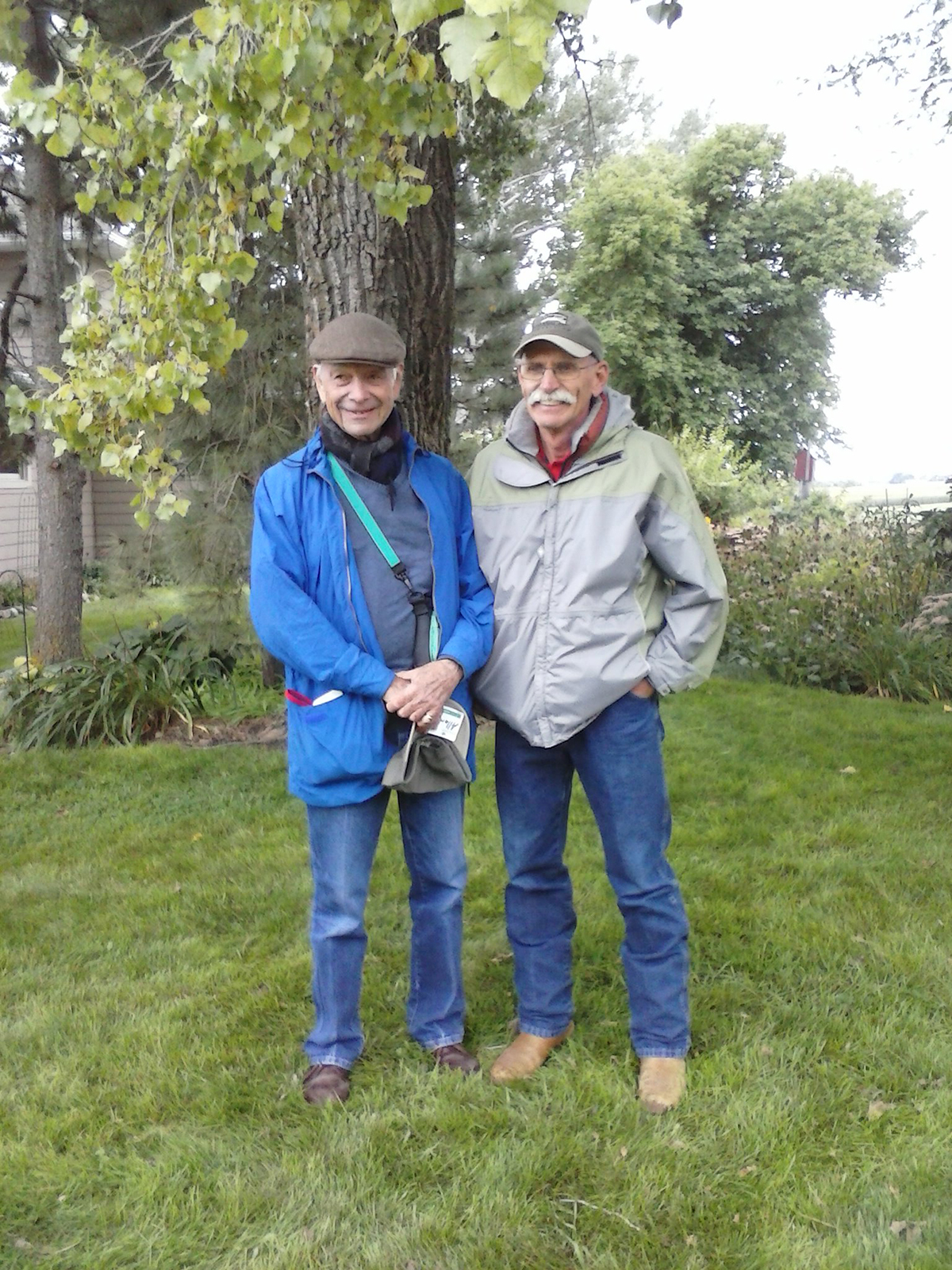 Allan Savory, left, visited Rick Smith, right, at Smith's farm in 2014, as part of a tour of farming operations practicing exemplary conservation agriculture. Savory, a world-renowned expert on grassland systems and holistic management, resides in South Africa. He was honored in 2010 as a recipient of the prestigious Buckminster Fuller Award for his work solving agricultural and land use problems. Photo courtesy the South Dakota Grasslands Coalition
