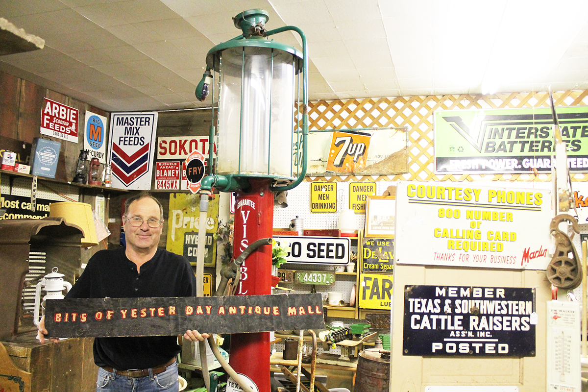 Randy Bullis stands next to his prized procession: a 1930s-era manual gas pump. Photo by Jason Uphoff
