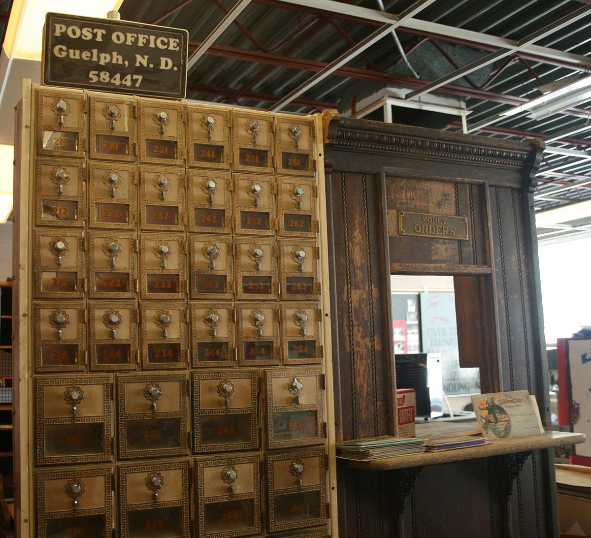 Other parts of the school building are used as museum space, telling Guelph's history. Here, boxes and the service window from the old post office are on display. Museum items have been donated from many families, so the stories they tell cover many aspects of past community life.