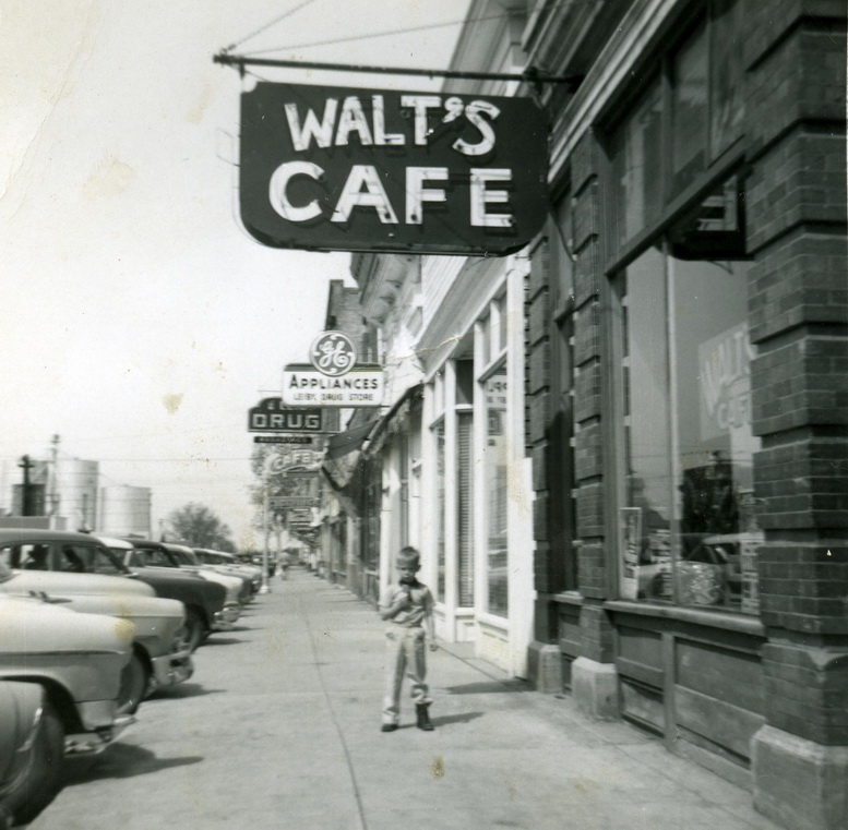 Alan under Walt's cafe sign
