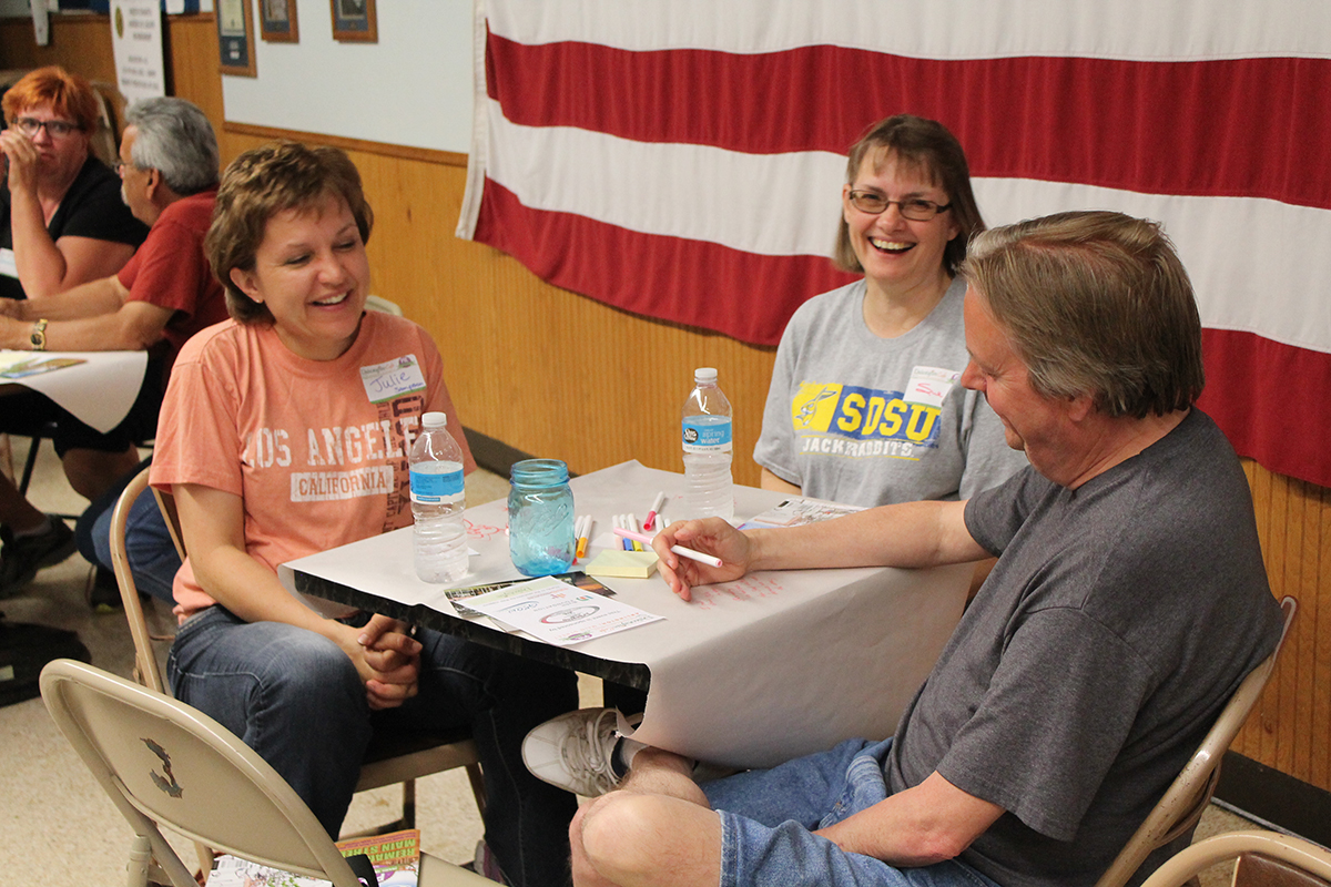 Participants share some smiles and good conversation at the Dakotafire Café in Arlington on May 27. Photos by Jason Uphoff