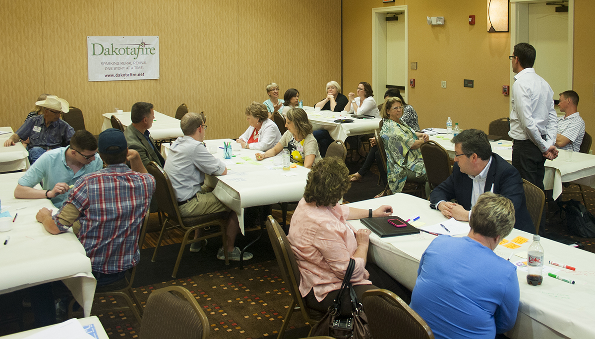 Participants listen during the Prairie Idea Exchange harvest. Photos by Heidi Marttila-Losure