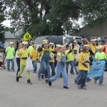 Elementary students march through a homecoming parade in Frederick, S.D. Community-building experts say bringing young adults back into the community starts with events such as homecoming, when alumni are back in town to visit.