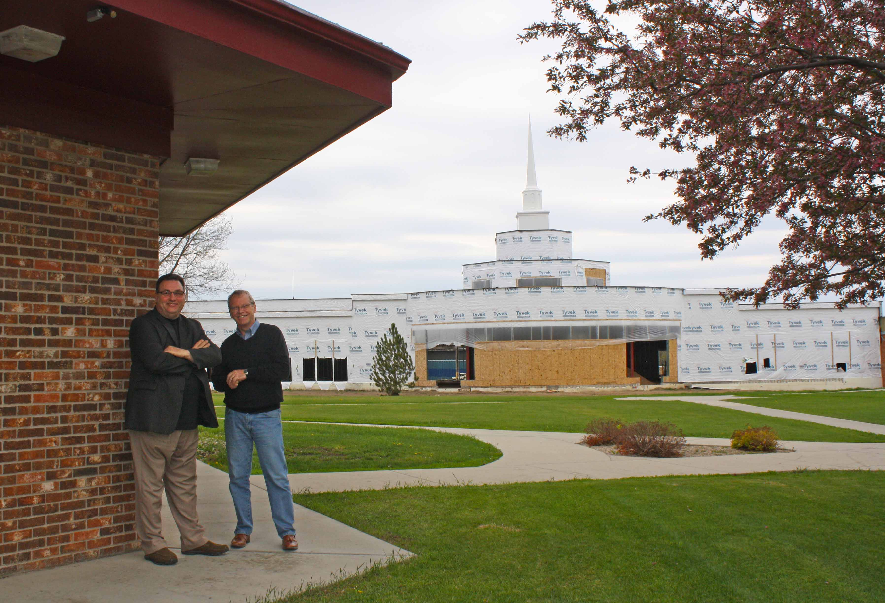 Dan Kuno (left), a former Trinity Bible College employee who also was among the school's first freshmen class on the Ellendale class in 1972, and President Paul Alexander stand in front of the new prayers chapel.