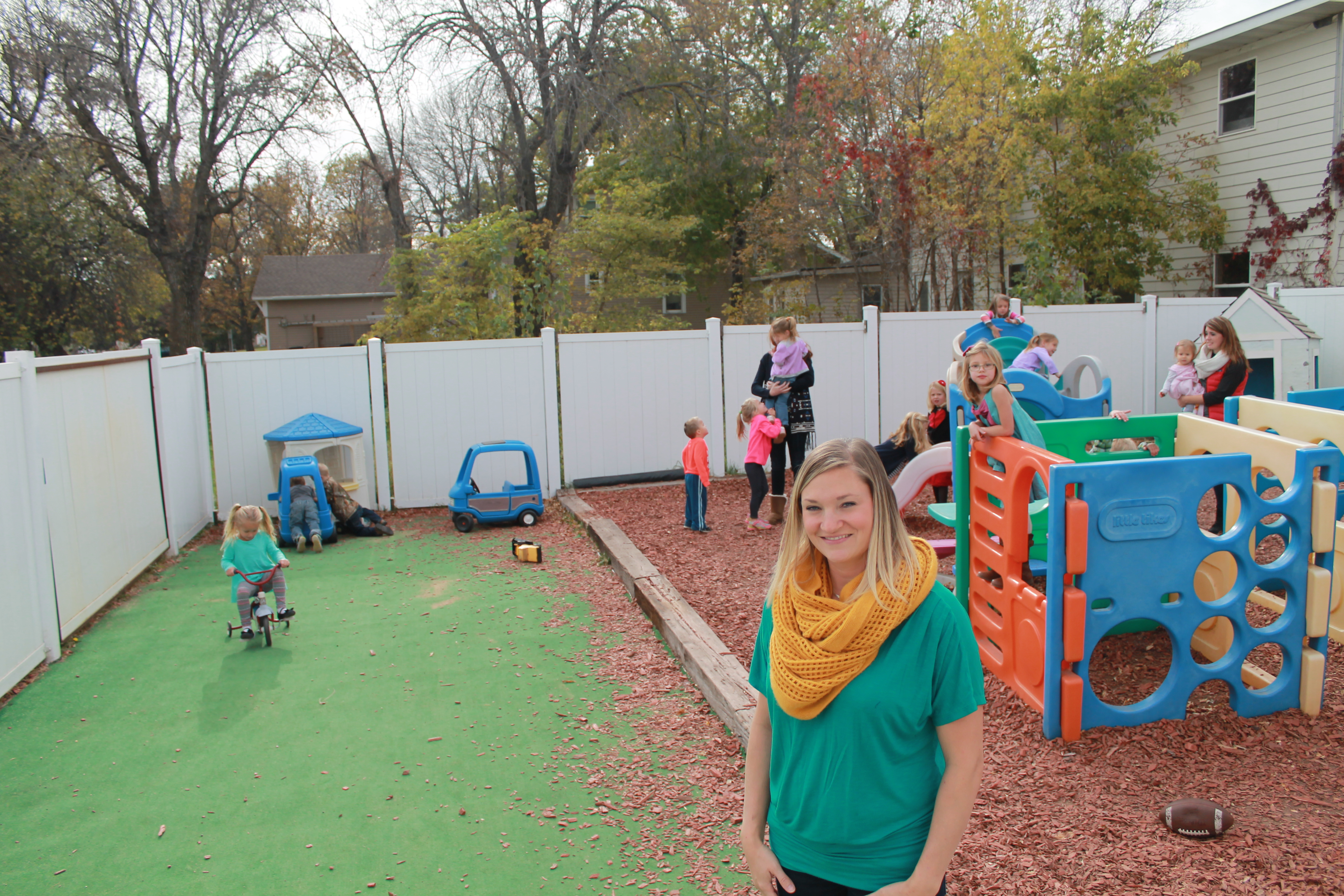 Above: Amber Uphoff, director of Arlington's community day care, says she can't imagine raising her family anywhere else after moving from a larger city last year.