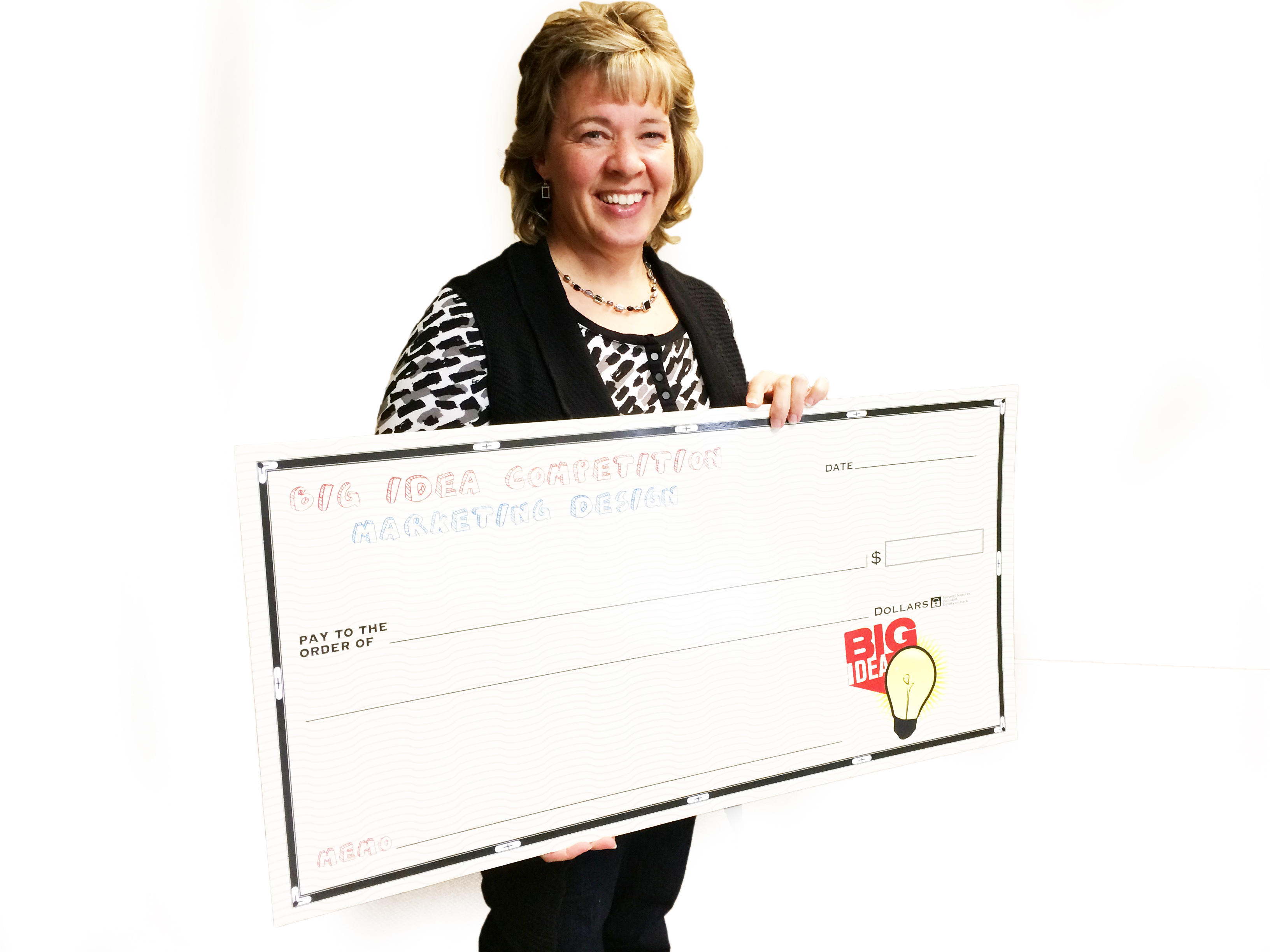Kelly Weaver has checks ready to present to each of the winners in the Big Idea contest. Photo by Heidi Marttila-Losure