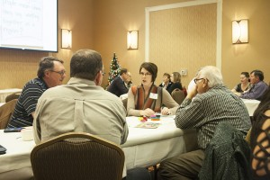 Kristin Brekke Vandersnick, center, discusses regional efforts at the Prairie Idea Exchange on Dec. 9. Photo by Heidi Marttila-Losure
