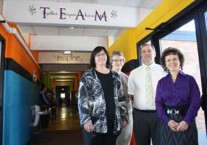 Members of the White Lake teaching staff gather in the breezeway that connects the elementary classrooms to the two-story schoolhouse. Superintendent Bob Schroeder (pictured with, left to right, Sandy Nightingale, Marcia Schuldt and Paulena Hanten) said that corridor is one of many catalysts for a new building project, because its design and access to the school's backyard community daycare have created a vulnerability for students and staff.