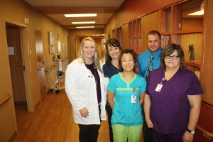 Douglas County Memorial Hospital's success as a minority independent health care organization lies within its board of directors' foresight and investments, according to Administrator Heath Brouwer, pictured with (back row, from left) Physician Assistant Amber Wolter, Registered Nurse Pam Blume, (front row) Registered Nurse Annie Rolston and Certified Nurse Aide Jody Wright.