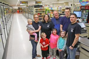 Krull's Market has been in the Krull family since Dana Krull's parents purchased it in 1969. Today, his own descendants regularly can be found in the store. Pictured, left to right (front row): grandson Abel Slate, daughter Molly Krull, daughter Sarah Krull, (back row), granddaughter Audrey Slate, daughter Eden Slate, wife Jennifer Krull, Dana Krull, son Seth Krull and son-in-law Dylan Slate.