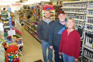 Tyler Wilson (left) works with his parents, Larry and Ronda Wilson, at Wilson True Value and is expected to eventually take over the family store.