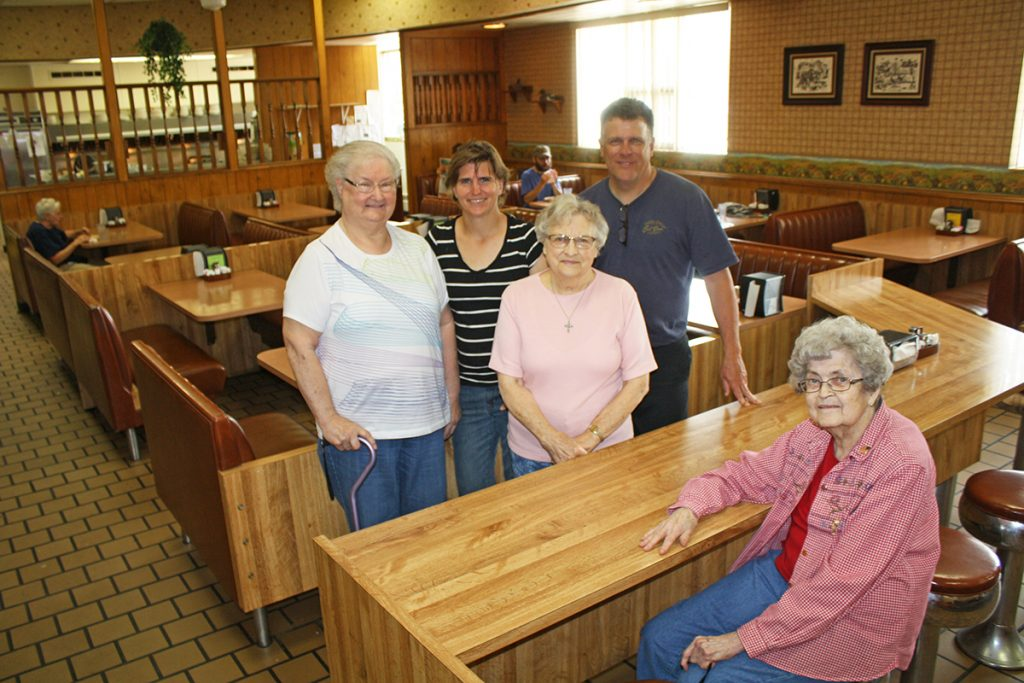 From left, Shirley Jungwirth, Karen Gall, Janette Noyes and Lee Noyes are some of the faces that customers see at Leo's Good Food. Seated is one of those longtime customers, Juanita Sanger. Photo by Wendy Royston/Dakotafire Media