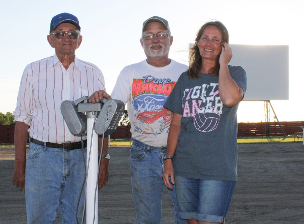 Clark Davis and Dave and Stacey (Davis) Marlow purchased Pheasant City Drive-In movie theater in 2014. The theater is one of just six drive-ins still open in the state. Photo by Wendy Royston/Dakotafire Media