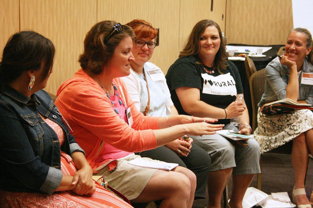 Emily Pieper, second from left, tells her story at RuralX in Aberdeen in July. Pictured with her, from left, are Eileen Briggs, Liz Hannum, Wendy Royston and Angela Tewalt. Photo by Heidi Marttila-Losure/Dakotafire Media