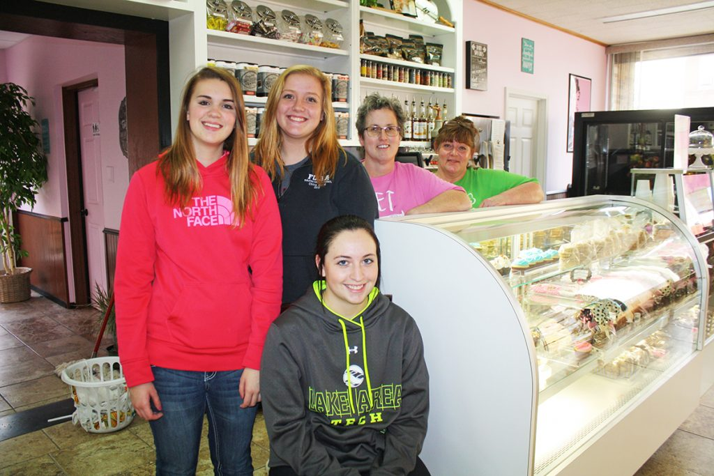 Diane Hepburn (far right) and Trish Meek (second from right), pictured with employees Brandy Melius (in front), Megan Kones (left) and Chloe Brand, say the key to business in a small town is diversity. The duo has sold baked goods, gourmet candies, coffees, and lunch specials at Muffin Tops—and gift items on the lower level Muffin Bottoms—in downtown Faulkton, S.D., since this summer. Photo by Wendy Royston