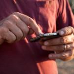 Farmer using smart phone