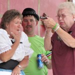 "Trial by marksmanship for Dead-Eye Millie Hansen resulted in a ""surprise"" guilty verdict. Keeping an eye on where she pointed the gun are Susan and Kirk Schaefers. The drama was part of the Orient, S.D., 125th Celebration July 6-8. Photo by Faulk County Record"