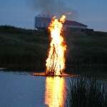 The juhannuskokko, or midsummer bonfire, burned brightly on the Maple River in Frederick. The bonfire is a midsummer tradition in Finland and now in Frederick. Photo courtesy fredericksd.com