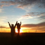 Silhouetted kids in Dakota sunset. Photo by Heidi Marttila-Losure