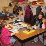 Activities that are fun as well as educational are offered at Clark's after-school program. Here, paraprofessional Lori Bjerke assists Gabe Ashley with an art project. From left to right clockwise around the table are Corbin Wagner, Lincoln Reidburn, Connor Mudgett, Jada Wagner, Bjerke and Ashley. Photo by Clark County Courier