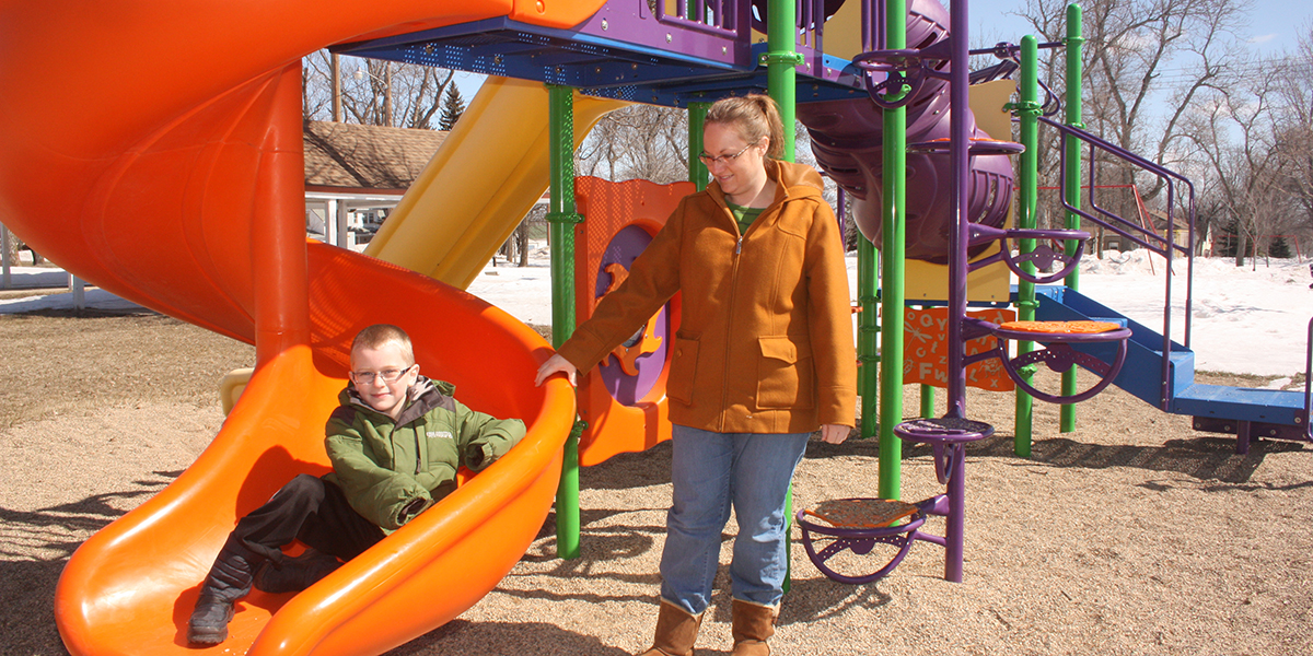Beth Helkenn and her son, Jack, enjoy the play equipment at ...